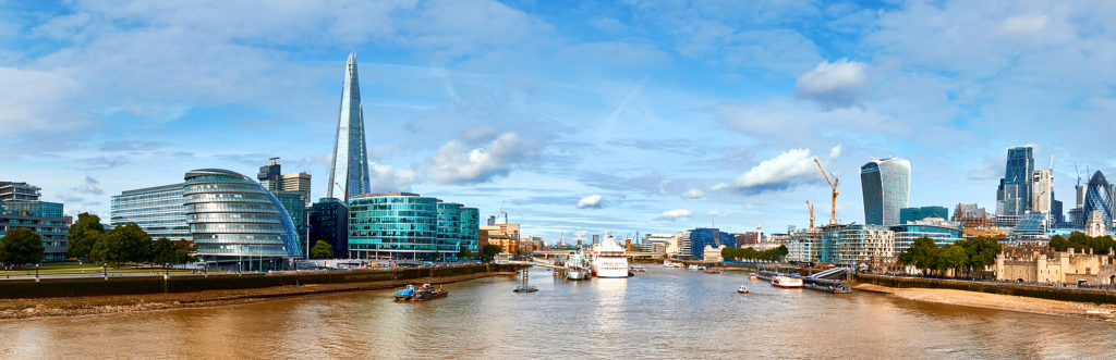 London, South Bank Of The Thames on a bright day. Panoramic image taken from the Tower bridge. Photo licensed from BigStockPhoto